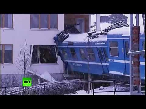 Female cleaner steals train, derails it and crashes into an exclusive Swedish apartment block