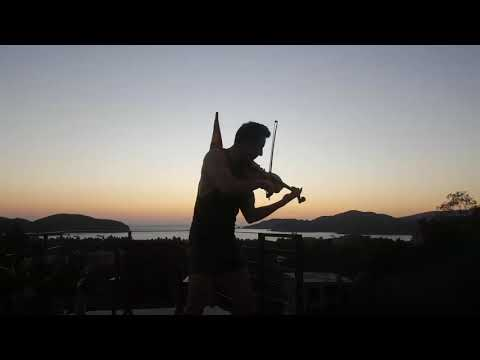 "The ""Shirtless Violinist"" playing on our rooftop pool at sunset."