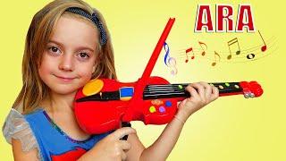 Ulya يلعب لعبة الموسيقى الكمان تحديا ، والغناء أغاني الأطفال