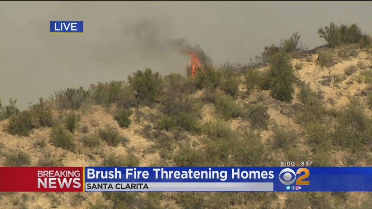 SoCal freeway shut down by rapidly-growing brush fire threatening homes, power lines