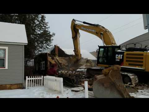 Watching a House Demolition