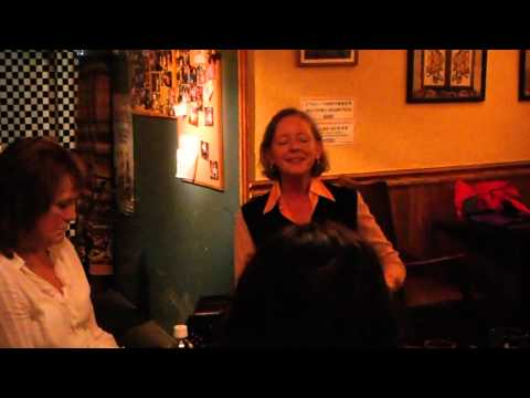 Felicity Greenland  singing around the Table with Swosaimhin Ni Bheaglaoich