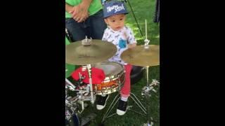 Maxus playing the drum set