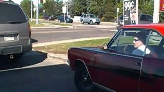 a old dodge gt car starting up and driving off from the 34st 7eleven edmonton