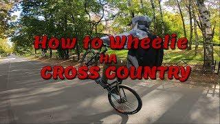 Езда на заднем колесе на велосипеде Обучение вилли на кросс-кантри