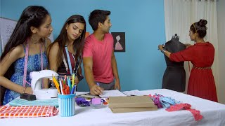 A creative team of students and a teacher discussing how to take measurements in fashion designing class