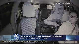 Police investigate taxi robbery caught on surveillance video