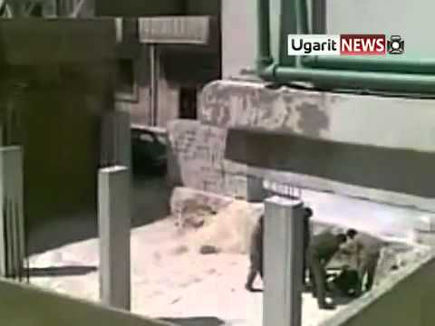 Syria - Homs - City - 20110628 -  A group of soldiers beat a unarmed man with sticks
