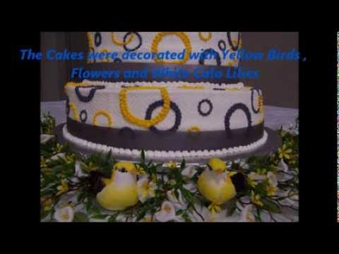 3-tiered-wedding-cake---yellow-&-grey-with-birds-and-calla-lilies