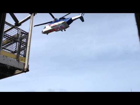 Helicopter offshore North Sea take off oilfield transport UK Aberdeen