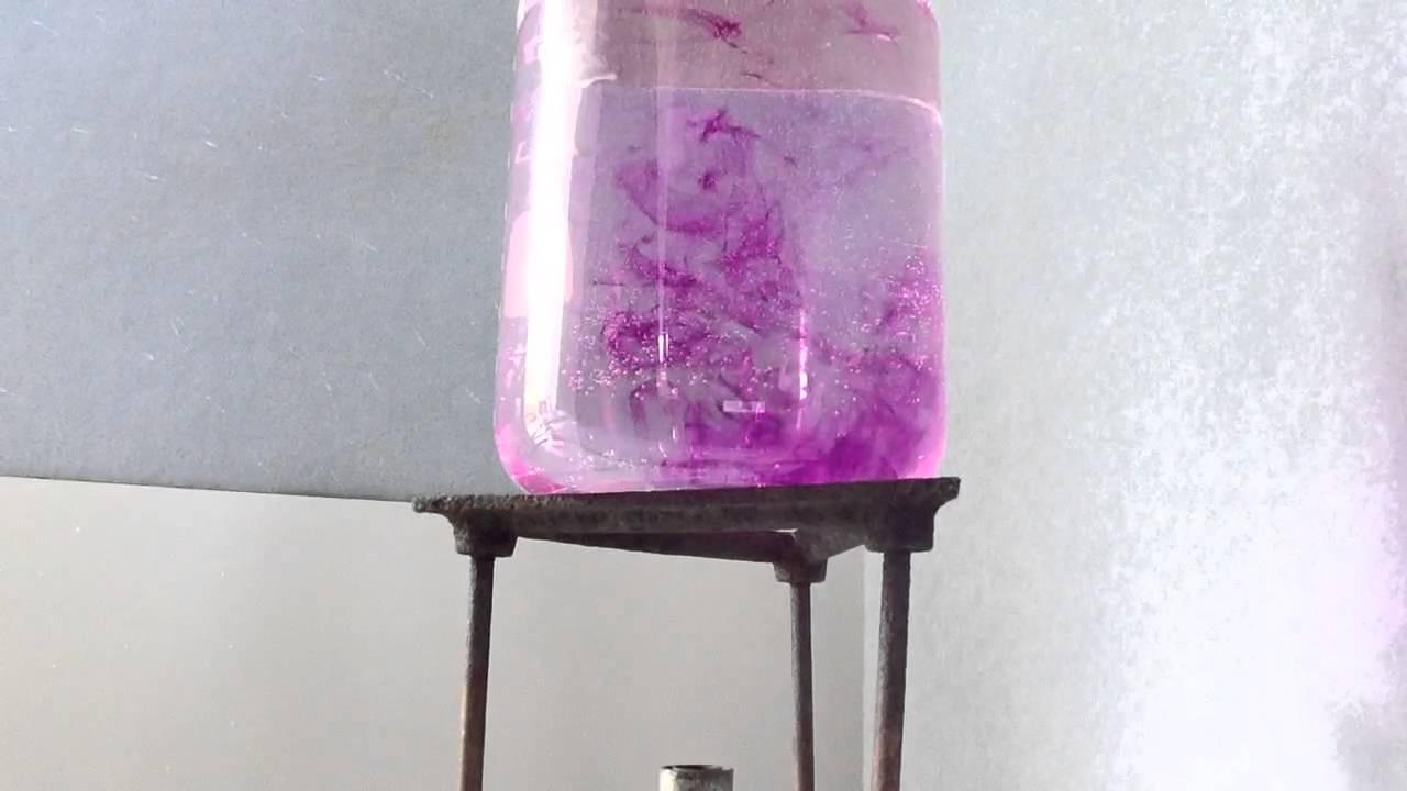 diffusion of potassium permanganate crystals in water