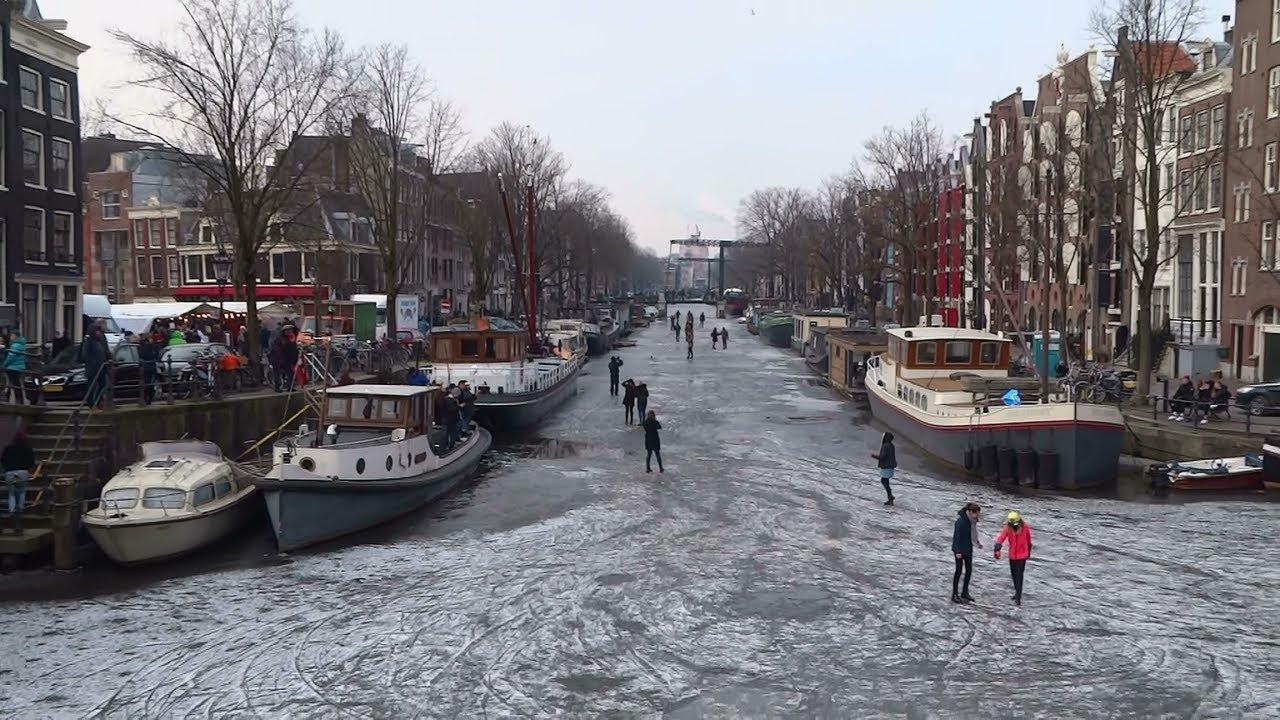 schaatsen op grachten amsterdam mooi leuk en gevaarlijk