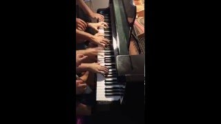 Impossible Piano Waltz for 14 Players on 1 Piano
