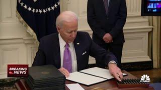 President Joe Biden signs Covid-19 executive orders