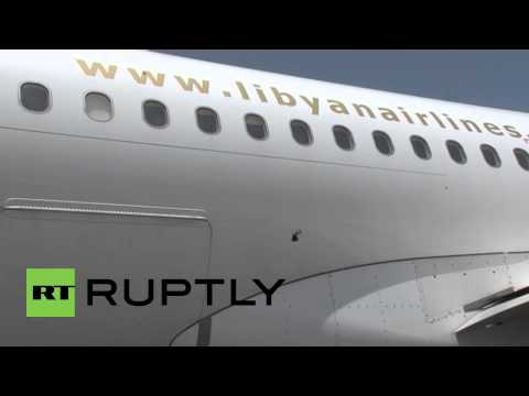 Libya: Rocket attack leaves smashed planes on tarmac at Tripoli airport
