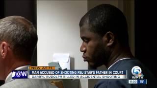 Police say <b>Travis Rudolph's</b> father killed by AK-47