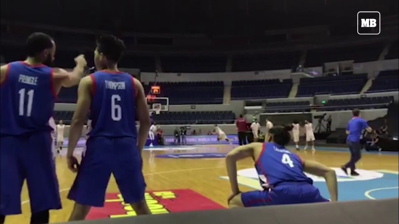 Philippines and Qatar players warm-up before their closed-door match of the FIBA
