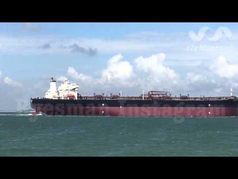 Oil tanker ship passing by Changi Beach...