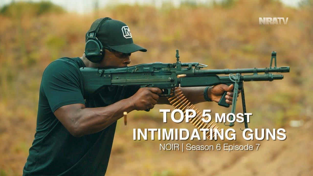 Intimidating man with gun