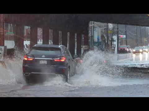 Raw video: Drivers negotiate flood waters in Clifton