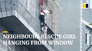 Download Neighbours rescue girl hanging from fourth-floor window in China