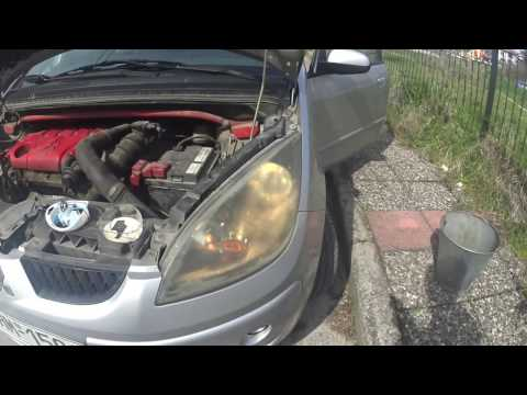 How to replace the headlight bulb in a Mitsubishi Colt