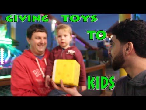 GIVING TOYS TO KIDS IN SANTA MONICA!
