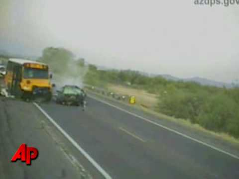 Raw Video: Car Hits School Bus Head-On