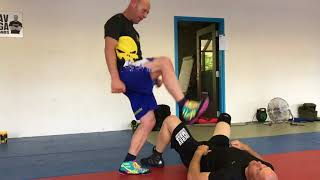 Clam defense vs jumping stomping kick, with Amnon Darsa at Expert, Institute Krav Maga Netherlands.