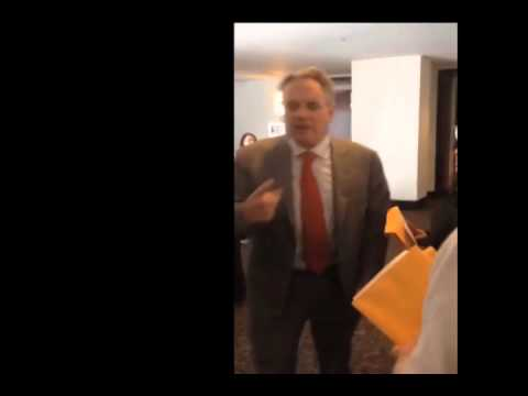 NUHW members confront Kaiser director Phil Marineau