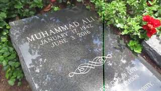 Kevin Grace visits the grave of boxer Muhammad Ali on the eve of 2nd anniversary of his passing
