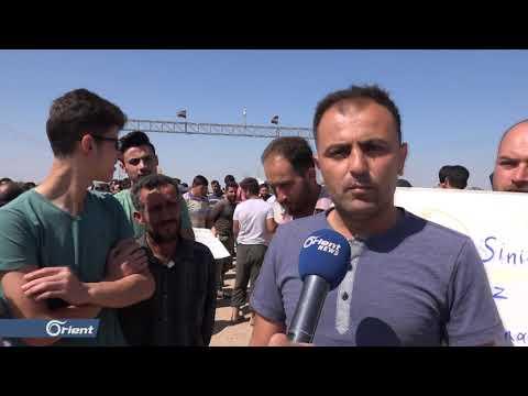 أصحاب الشاحنات يعتصمون أمام باب السلامة بسبب دخول السيارات التركية ما أدى إلى توقف أعمالهم  - 14:54-2021 / 6 / 12