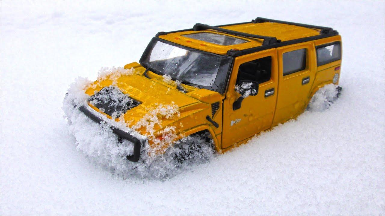 Various SUVs Moving Through Snow Outdoors 4k