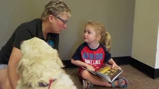 Tristen reading to service dogs at the library.
