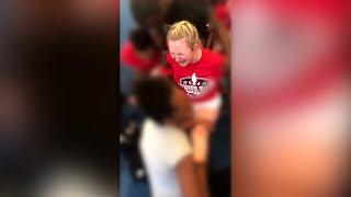 VIDEO: Cheerleader forced to do split despite pleas to stop