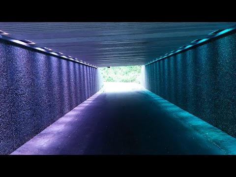 Walking and cycling tunnel with disco light, artistic touch added by editor