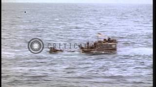 German U boat -505 being towed by USS Guadalcanal in the Atlantic Ocean during Wo...HD Stock Footage