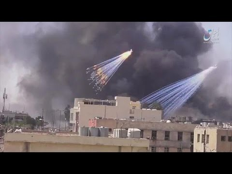 Iraqi government accused of firing white phosphorus shells into Mosul