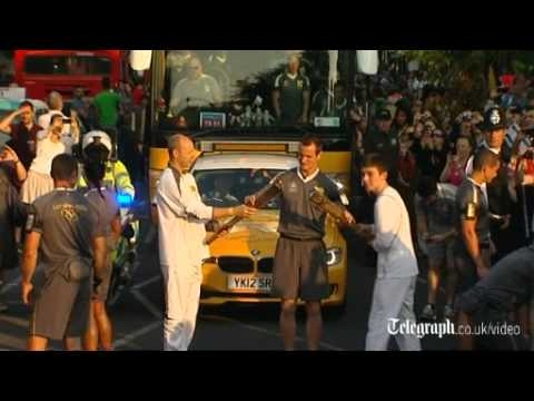 Clive Woodward lifts Olympic torch in Camden