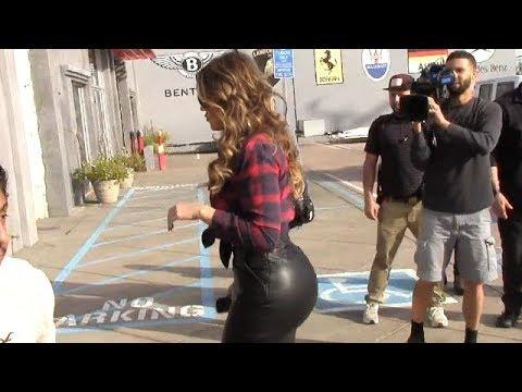Khloe Kardashian Flaunts Curves In Skin-Tight Leather Skirt [2014] thumbnail