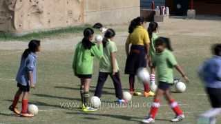 Kids playing football (OK, soccer!) at The Shri Ram School