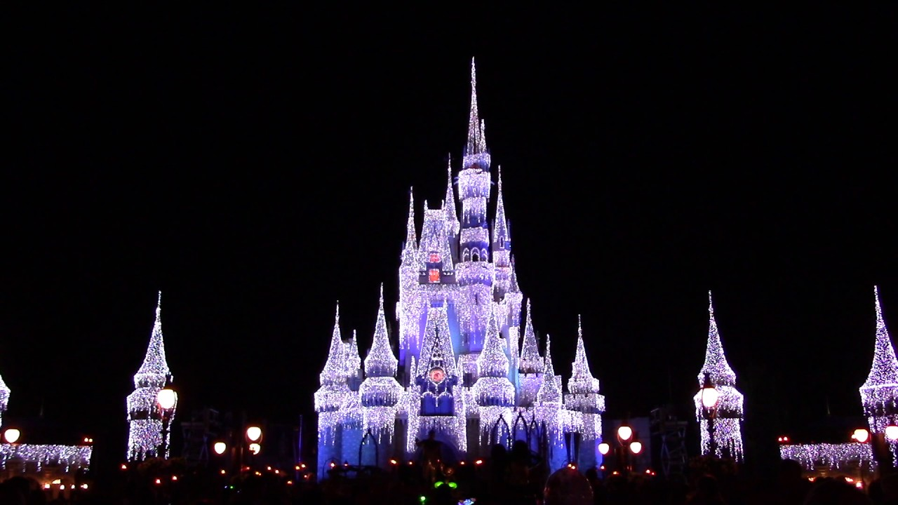 cinderella castle with holiday lights nighttime christmas atmosphere the magic kingdom