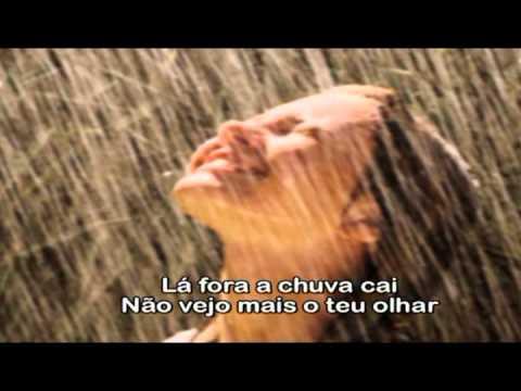 Os Travessos- La fora a chuva cai