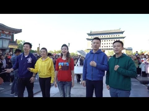 Hundreds sing 'I Love You China' in Beijing flash mob