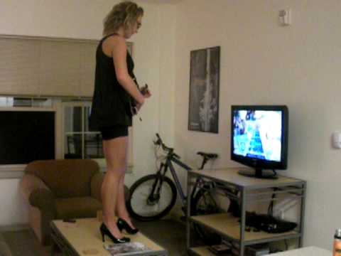rockin' out to guitar hero on nathan's coffee table..in heels
