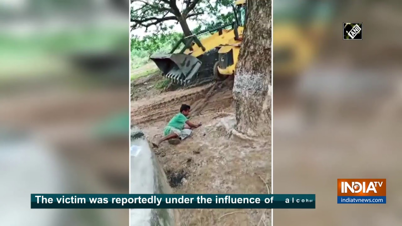 Watch: Driver hits man with JCB`s arm in Telangana`s Mulugu