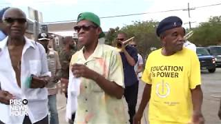 Trombone Shorty joins a 'second line' in New Orleans' Treme neighborhood