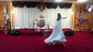 Young adult ministering in dance to Fill me up