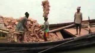Hard Labour, Guy Stacking 20 Bricks on His Head