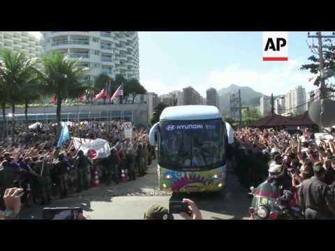 Fans watch Argentina team bus pass en route for World Cup final